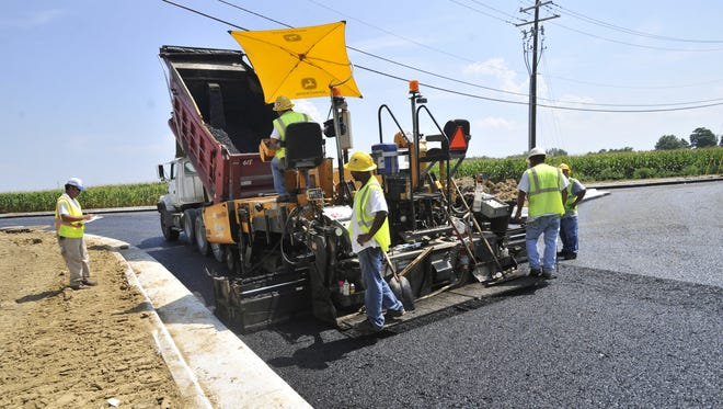 A crew from Rieth-Riley Construction Co. laid asphalt on a roundabout at Dan Jones Road and Hendricks County Road 200 South in Avon in 2010.