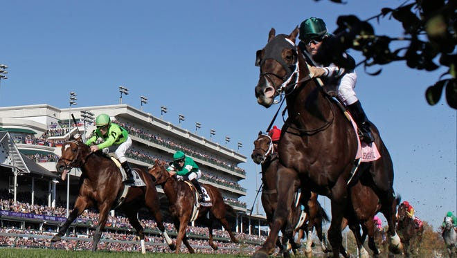 Corey Nakatani rides Regally Ready (inside) to victory in the 2011 Breeders' Cup Turf Sprint at Churchill Downs.