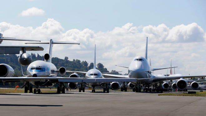 Boeing 7-series passenger airplanes sit parked in a lineup formation during an event marking the 100th Anniversary of the Boeing Co. on July 15, 2016, in Seattle.
