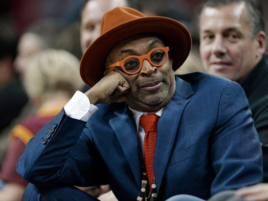Spike Lee jokes around in the second half of an NBA basketball game between the Golden State Warriors and the Cleveland Cavaliers, Monday, Jan. 18, 2016, in Cleveland. The Warriors won 132-98. (AP Photo/Tony Dejak)