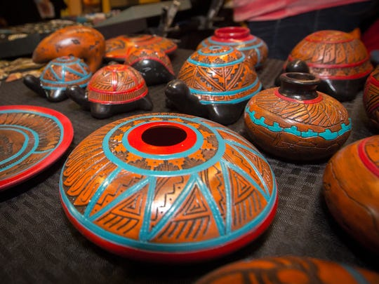 Brihiannon Kinsel, whose red clay pottery is shown here, is carrying on Diné (Navajo) traditions that stretch back several generations in her family.
