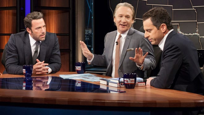 """Bill Maher, center, talks with actor Ben Affleck, left, and Sam Harris, author of """"Waking Up: A Guide to Spirituality Without Religion"""", during """"Real Time With Bill Maher,"""" in Los Angeles on Oct. 3, 2014."""