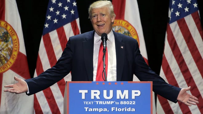 This June 11, 2016 file photo shows Republican presidential candidate Donald Trump gesturing during a campaign speech in Tampa, Fla.