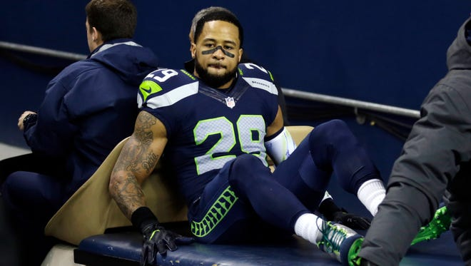 Seattle Seahawks safety Earl Thomas leaves the field on a cart after being injured against the Carolina Panthers in the first half of an NFL football game, Sunday, Dec. 4, 2016, in Seattle.