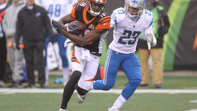 Bengals WR A.J. Green breaks a tackle from Lions CB Darius Slay during the second half on Sunday, Dec. 24, 2017, in Cincinnati.