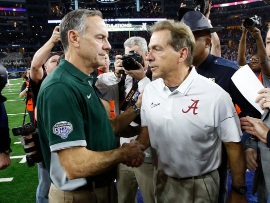 Nick Saban shakes hands with Michigan State coach Mark Dantonio after Alabama's shutout win in the 2015 Cotton Bowl.