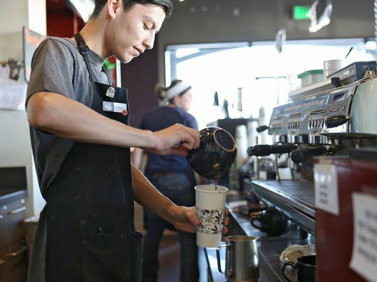 Edgar Montes creates a beverage at Sip Coffee House