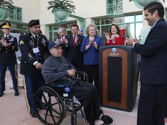 In this photo Mitchell Higgenbotham, 94, one of the last living World War II Tuskegee Airmen, is recognized during the Veteran's Day Tribute and Recognition Ceremony at La Quinta City Hall, Nov. 11, 2015. Higginbotham died on Feb. 14, 2016.
