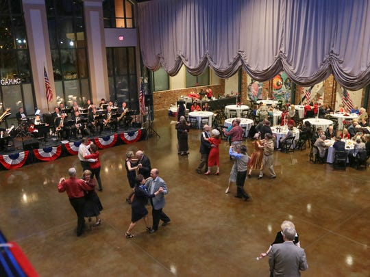 People dance Saturday to the music of the Electric City Big Band at the GAMAC USO Sweetheart's Dance at The Bleckley Station in downtown Anderson.