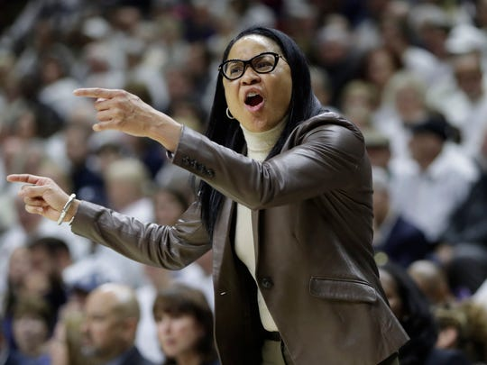 South Carolina  head coach Dawn Staley watches from