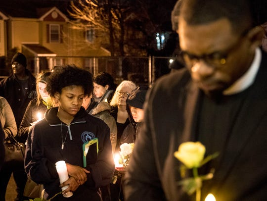 Mourners gather at the Boys & Girls Clubs of Monmouth