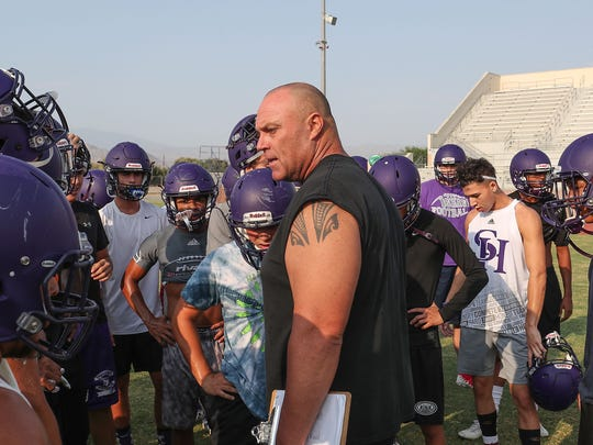 The Shadow Hills football Ron Shipley talks with the team at practice, August 10, 2018.