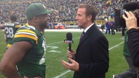 Bob Holtzman, a commentator and bureau reporter with ESPN, interviews Green Bay Packers wide receiver Randall Cobb at Lambeau Field. Holtzman has spent a lot of time in Green Bay in the last two weeks.