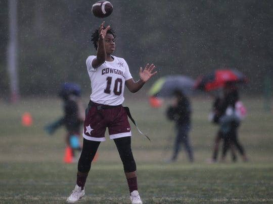 Madison County quarterback Zharia Norwood throws a pass as heavy rain falls during the 2018 Capital City Classic.