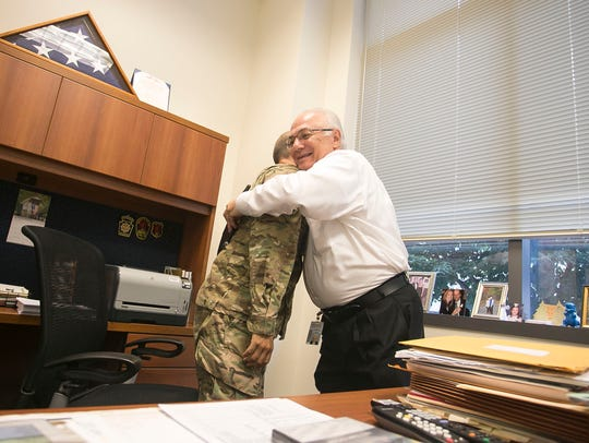 Register of Wills Bradley Jacobs hugs York County Clerk