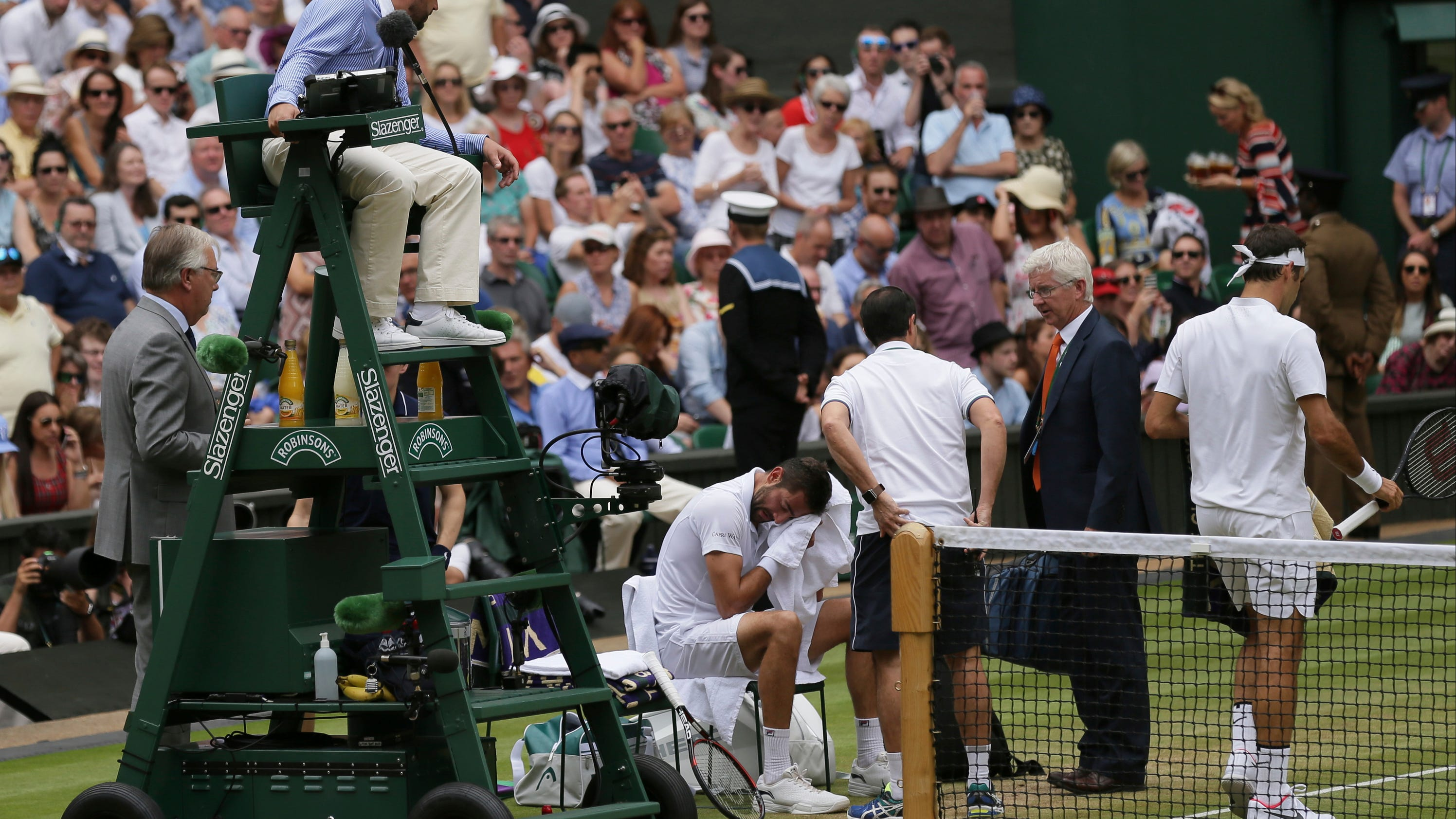 Cilic in pain and tears in Wimbledon final against Federer