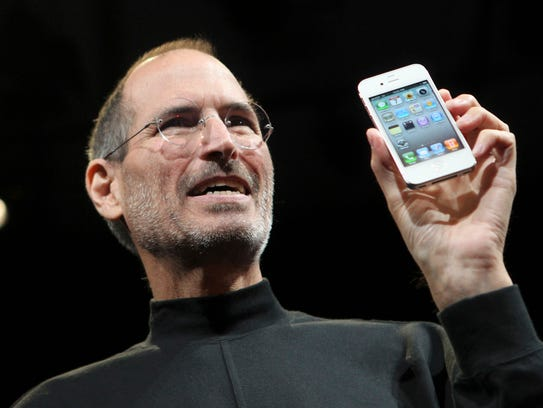 Apple CEO Steve Jobs shows the new iPhone 4 during