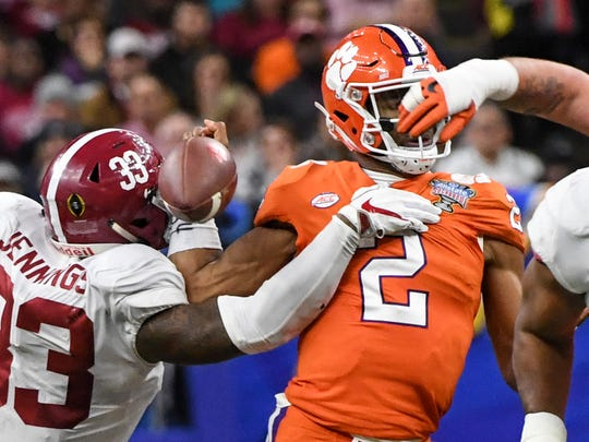 Alabama linebacker Anfernee Jennings(33) strips the ball from Clemson quarterback Kelly Bryant(2) during the fourth quarter of the Sugar Bowl in New Orleans on Monday, January 1, 2018.