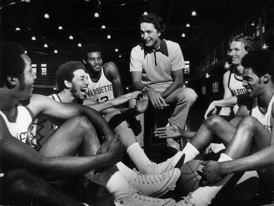 MCGUIRE, AL: (CENTER) Al McGuire swaps a story with players (clockwise from left) Butch Lee, Bo Ellis, Earl Tatum, Rick Campbell and Lloyd Walton in 1974.