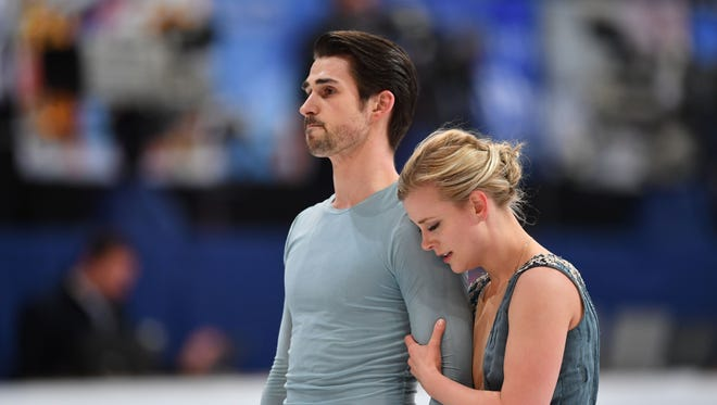 Madison Hubbell and Zachary Donohue react after competing in the free dance event at the ISU World Figure Skating Championships in Helsinki, Finland on April 1.