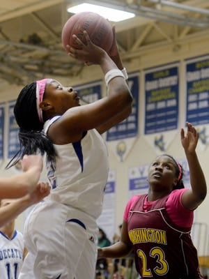 Stephen Decatur's Dayona Godwin takes a shot that would give the Decatur player 1,000 points for her high school career on Jan. 6 against Washington in Berlin. Decatur won the game 77-6.