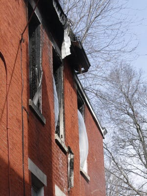 The damaged windows of a home on Apjones Street in Northside where a man jumped out to escape a fire.