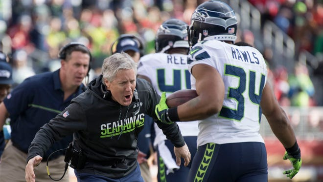 Seahawks coach Pete Carroll celebrates after running back Thomas Rawls scored a touchdown on a 1-yard run against San Francisco on Sunday.