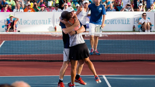 Partners Kyle Yates, a Fort Myers local, and Naples own Simone Jardim embrace after defeating Matt Wright and Lucy Kovalova during the Pro Mixed Doubles gold medal match during The Minto U.S. Pickleball Championships at East Naples Community Park Saturday, April 28, 2018. Yates and Jardime would go on to win the gold medal match in three sets.