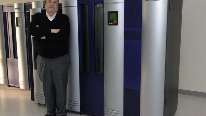 Tim Williams, CEO of Index Engines, stands in the company's Holmdel office.