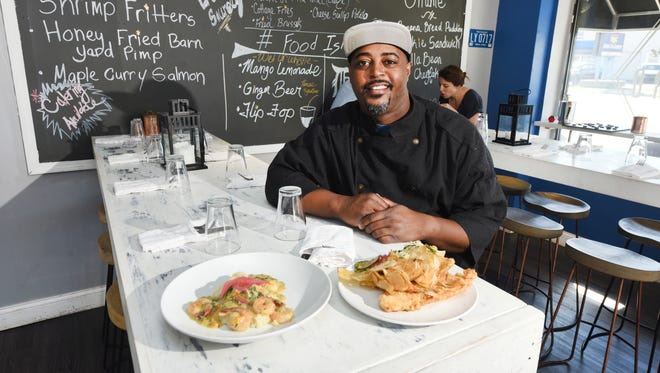 This is Max Hardy, owner and chef of River Bistro with the everyday fish fry plate  and the shrimp and grits plate at his Detroit restaurant .