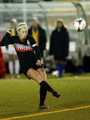 Loveland's Riley Massey passes to a teammate in the