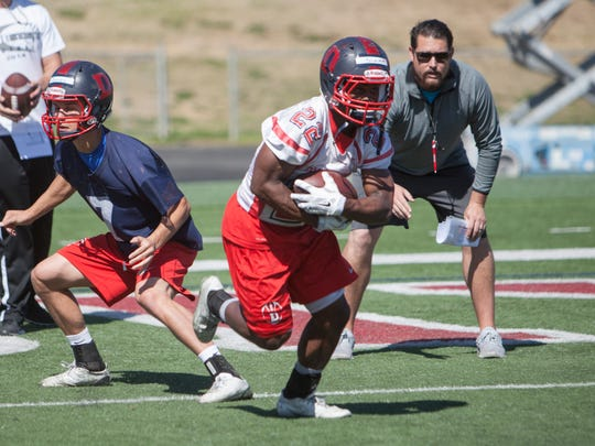 Clifford Simms, Dixie State running back and redshirt freshman, practices for the upcoming football season Friday, March 25, 2016.