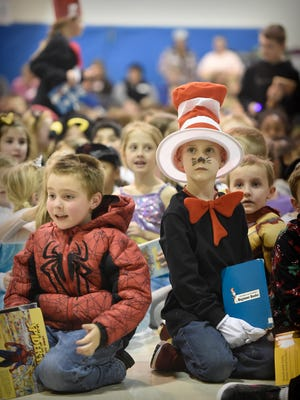 Union Canal Elementary students Brayden Popp, left, and Kayden Long dressed as their favorite book characters, Spiderman, and the Cat in the Hat, respectively on Friday, March 4, 2016, at the school's Read Across America celebration. Students and teachers held a parade dressed like their favorite book characters. See the photo gallery of the parade at LDNews.com.