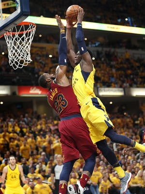 Indiana Pacers guard Victor Oladipo (4) goes up for a dunk on Cleveland Cavaliers forward LeBron James (23) during the second half of Game 6 at Bankers Life Fieldhouse on Friday, April 27, 2018.