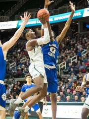 Grand Rapids Catholic Central's Marcus Bingham Jr. (23) jumps to block New Haven's Romeo Weems during Friday's Class B state semifinal at Breslin Center. Bingham is headed to MSU next year. Weems is one of MSU's top targets for 2019.