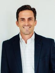First-year alumni association president Justin Bailey,