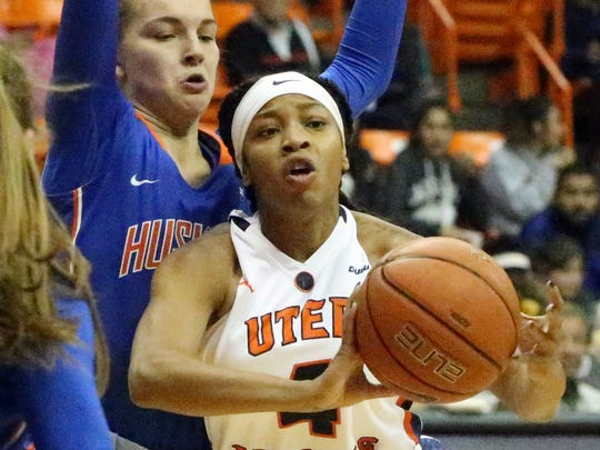 UTEP guard Lulu McKinney, 4, passes the ball away to a teammate at the Wednesday night game against Houston Baptist in the Don Haskins Center.