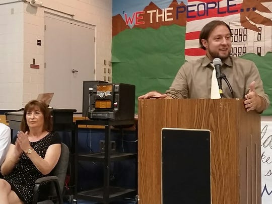 """New Mexico Public Education Secretary Christopher Ruszkowski, right, told attendees at a Mesquite Elementary School assembly on Thursday, Sept. 7, 2017, that the school district should be seen as a """"model"""" for the state because of its improvements in student performance. School Principal Angela Silvaggio looks on."""