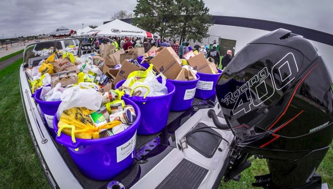 """It's its seventh year, Mercury Marine's """"Fill the Boat to Cast Out Hunger"""" food drive collected 4,000 food items and nearly $11,000 donations from employees."""