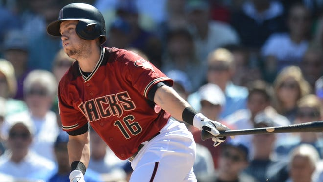 March 18, 2016: Arizona Diamondbacks second baseman Chris Owings (16) hits an infield single against the Los Angeles Dodgers during the second inning at Salt River Fields at Talking Stick.