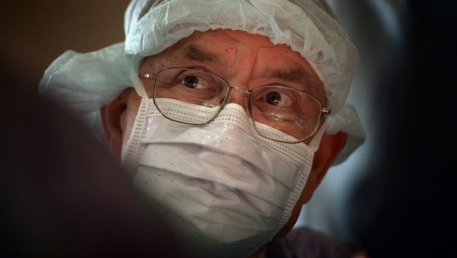 W. Dudley Johnson performs coronary bypass surgery at St. Francis Hospital on July 30, 1999, in Milwaukee.