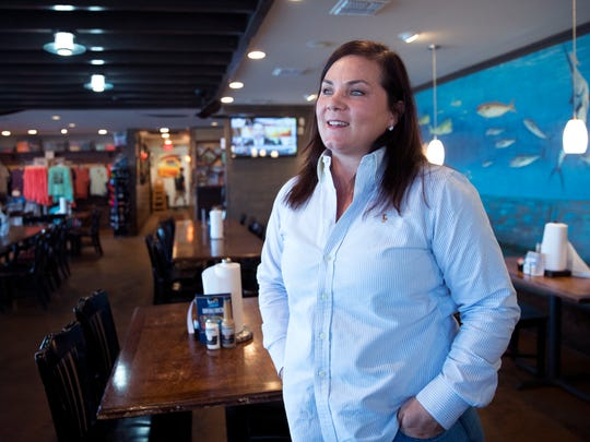 """Beth Owens owns several restaurants, bars and fishing charter businesses in Port Aransas along with her family. Following Hurricane Harvey, she said she and her husband knew they had to rebuild quick. """"We had to show everyone and us and just the feeling of rebuilding that we're going to get through this and we're going to recover,"""" she said. """"Port Aransas people they are doers."""""""