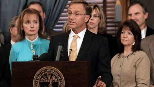 State Rep. Sheila Butt, R-Columbia, lower right, listens as Gov. Bill Haslam, center, speaks on Jan. 10, 2012. The Tennessee Legislative Black Caucus has said Butt should apologize for a Facebook post they say is racist. Haslam said Facebook is not the place for discussions about race relations.