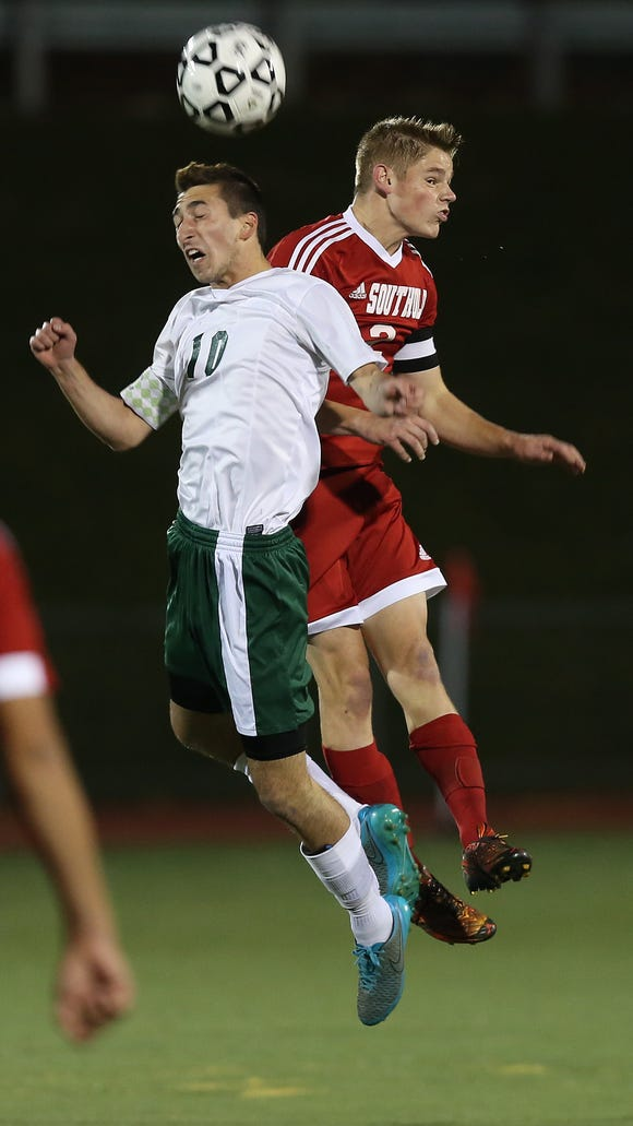 From left, Schechter's Daniel Kohen (10) and Southold's