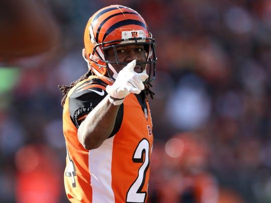 Cincinnati Bengals cornerback Adam Jones (24) points