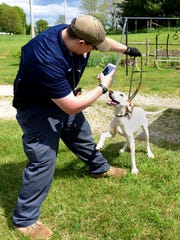 Fairfield County Deputy Dog Warden Jeremy Grant takes