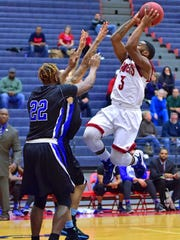 Shippensburg's Justin McCarthur, attempts a jump shot in front of Michael Oyefusi, of Cheyney, on Saturday. The Red Raiders won, 79-57.