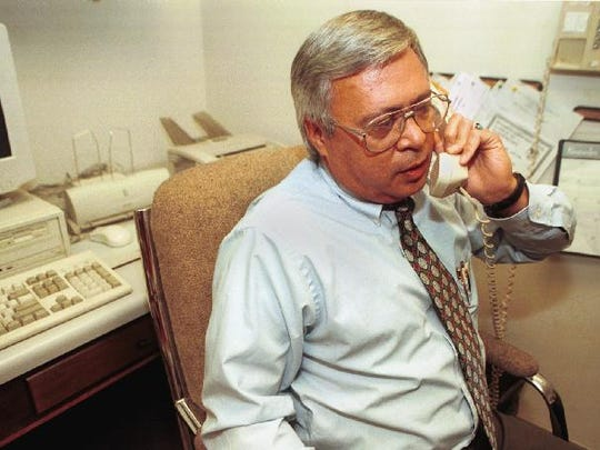Holley at his job as the Vestal Public Library director in 1998.