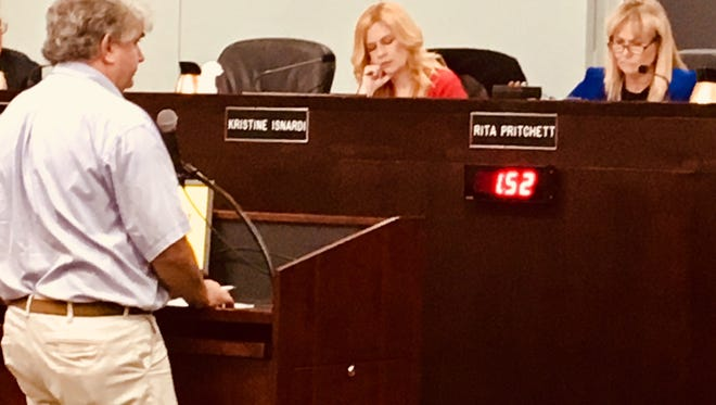 Brevard County Clerk of Courts Scott Ellis expresses his concerns to county commissioners about the legality of the county borrowing money to pay for Blue Origin's $8 million incentive grant. On the dais are County Commission Vice Chair Kristine Isnardi and Chair Rita Pritchett.