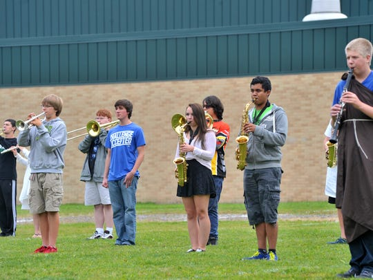 The D.C. Everest High School marching band rehearses Thursday afternoon, Oct. 2, 2014, at D.C. Everest High School in Weston.